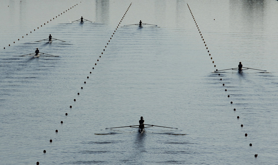 Photo -  Rowers head east toward the Interstate 35 bridge during the 4,000-meter on Oct. 2, the final day of the Oklahoma Regatta Festival on the Oklahoma River. [Photo by Doug Hoke, The Oklahoman Archives]