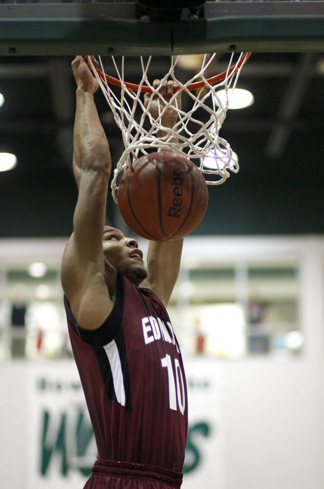 Edmond Memorial's Jordan Woodard dunks the ball during the boys' Edlam basketball game between Edmond Santa Fe and Edmond Memorial at Edmond Santa Fe High School in Edmond, Okla. , Tuesday, Jan. 24, 2012. Photo by Sarah Phipps, The Oklahoman