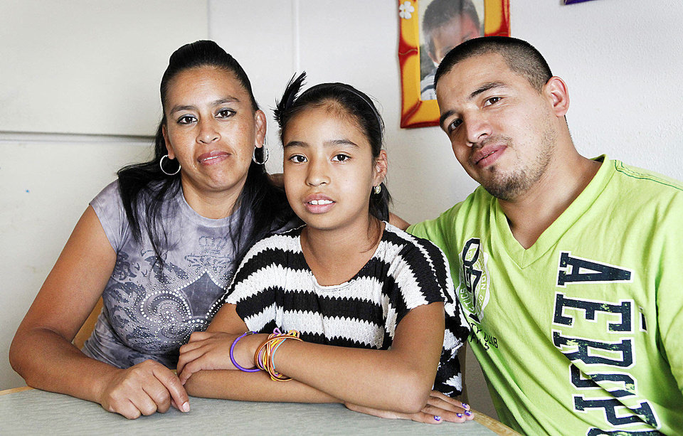 Photo - Erika Ramirez, who needs a kidney transplant, sits at home with her parents, Teresa Ramirez and Carlos  Guerra. Photo By David McDaniel, The Oklahoman