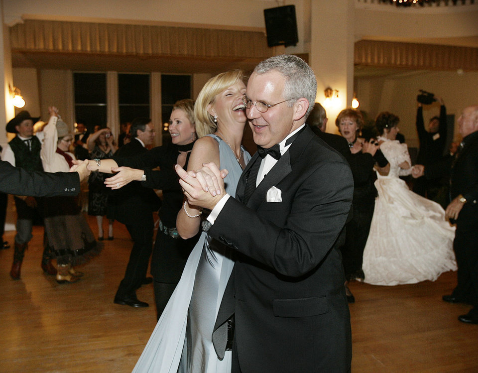 Photo - Gov. Brad Henry and his wife, Kim, dance the first official dance with others at the Oklahoma Centennial Statehood Inaugural Ball, Saturday, Nov. 17, 2007, at the Guthrie Scottish Rite Masonic Center, in Guthrie, Okla. By Bill Waugh, The Oklahoman
