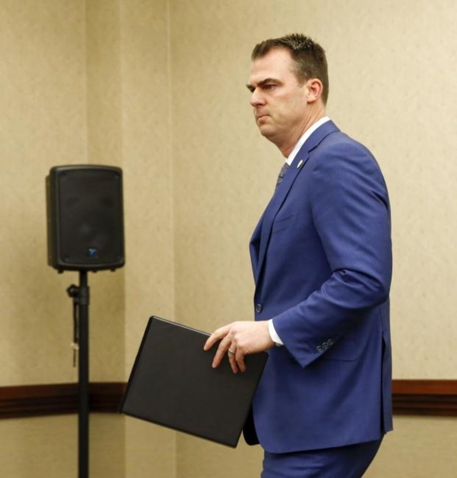 Photo -  Oklahoma Gov. Kevin Stitt arrives at a press conference announcing plans for Oklahoma to resume executions by lethal injection, at the Office of the Attorney General, 313 NE 21, in Oklahoma City, Thursday, Feb. 13, 2020. [Nate Billings/The Oklahoman]