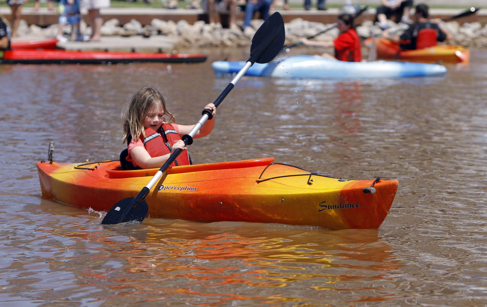 Photo - Katie Parrish tries a kayak during the Paddle Now! Youth Experience on the Oklahoma River,  Saturday, April 21, 2012. Photo by Sarah Phipps, The Oklahoman.