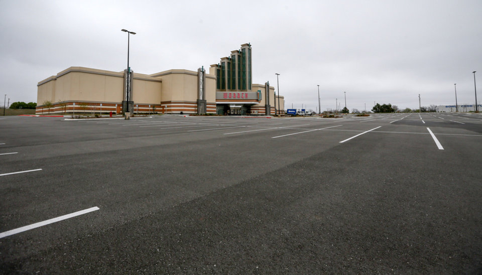 Photo - Exterior of the Warren Theatre with an empty parking lot as it is shutdown because of the coronavirus pandemic, in Midwest City, Okla., Monday, March 23, 2020. [Nate Billings/The Oklahoman]