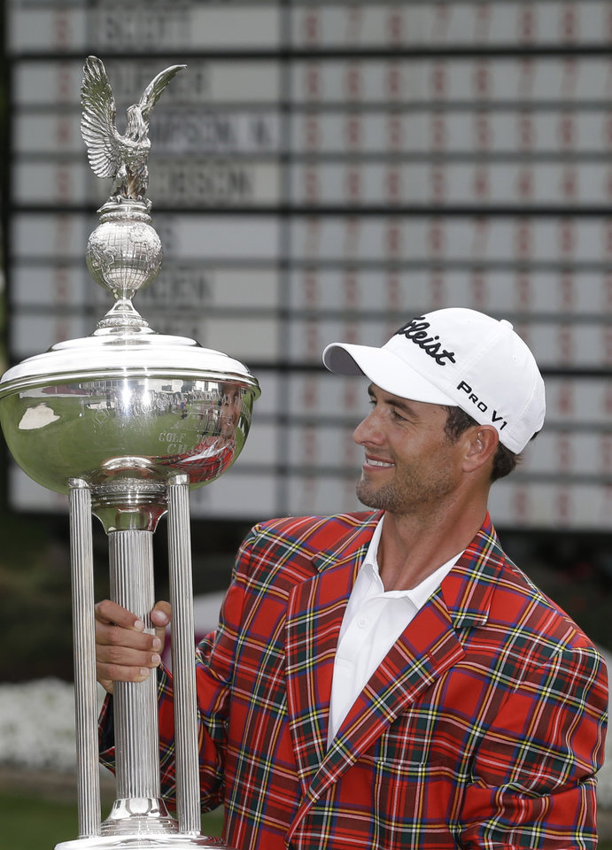 Photo - Adam Scott looks at the champion's trophy after winning the PGA Colonial golf tournament in Fort Worth, Texas, Sunday, May 25, 2014. (AP Photo/LM Otero)