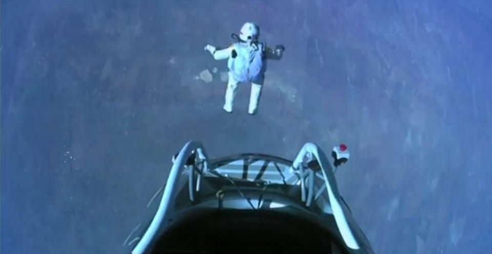 Photo -   This image made from video, provided by Red Bull Stratos shows pilot Felix Baumgartner of Austria as he jumps out of the capsule during the final manned flight for Red Bull Stratos on Sunday, Oct. 14, 2012. In a giant leap from more than 24 miles up, Baumgartner shattered the sound barrier Sunday while making the highest jump ever — a tumbling, death-defying plunge from a balloon to a safe landing in the New Mexico desert. (AP Photo/Red Bull Stratos)