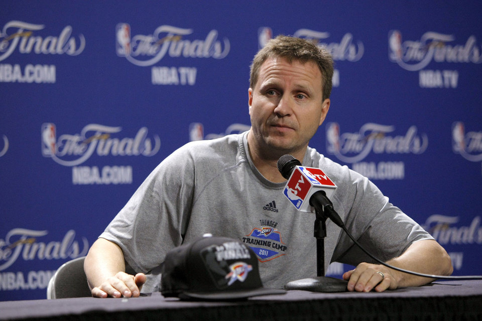 Photo - Oklahoam City coach Scott Brooks listens to a question during a press conference for Game 3 of the NBA Finals between the Oklahoma City Thunder and the Miami Heat at American Airlines Arena in Miami, Saturday, June 16, 2012. Photo by Bryan Terry, The Oklahoman