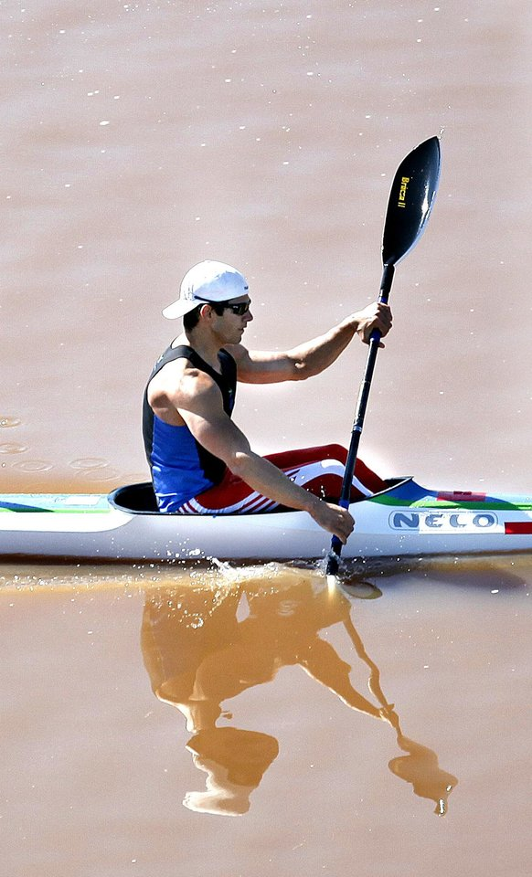 Carlos Garcia competes in the Men's single kayak 1000m Final A during races for the USA Canoe/Kayak World Cup Team Trials  on the Oklahoma River,  Saturday, April 21, 2012. Photo by Sarah Phipps, The Oklahoman.