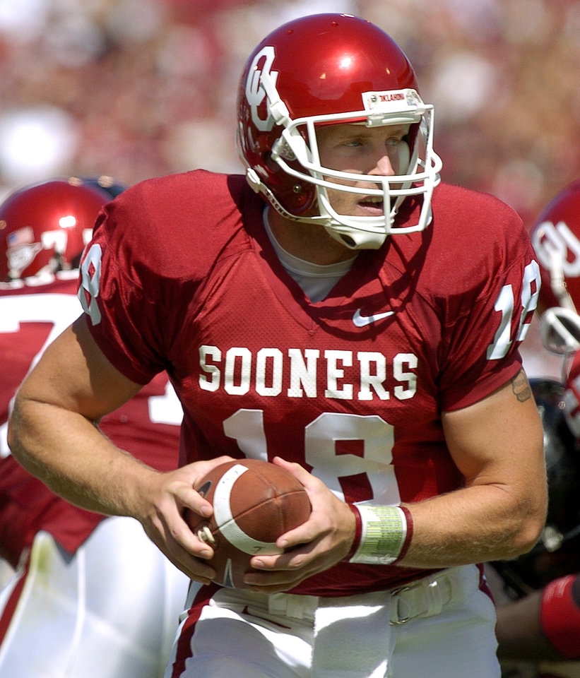 Photo - NORMAN, OK, SATURDAY, OCTOBER 2, 2004.  UNIVERSITY OF OKLAHOMA SOONERS VS TEXAS TECH AT THE GAYLORD FAMILY - OKLAHOMA MEMORIAL STADIUM IN NORMAN, OK.    COLLEGE FOOTBALL: OU Sooners quarterback Jason White looks downfield as he leads OU to a win against Texas Tech Saturday in Norman. White set a new OU record for touchdown passes in a career after his three TD tosses Saturday. Oklahoman photo by Ty Russell.