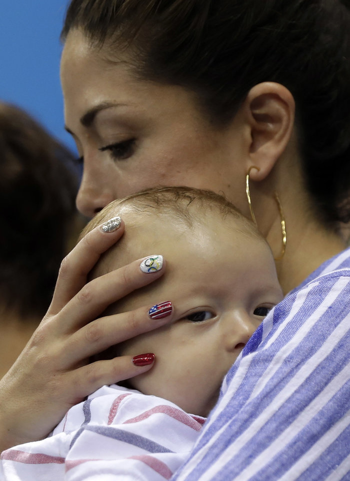 Photo - Fiance of United States' Michael Phelps, Nicole Johnson holds their baby Boomer during the swimming competitions at the 2016 Summer Olympics, Tuesday, Aug. 9, 2016, in Rio de Janeiro, Brazil. (AP Photo/Matt Slocum)