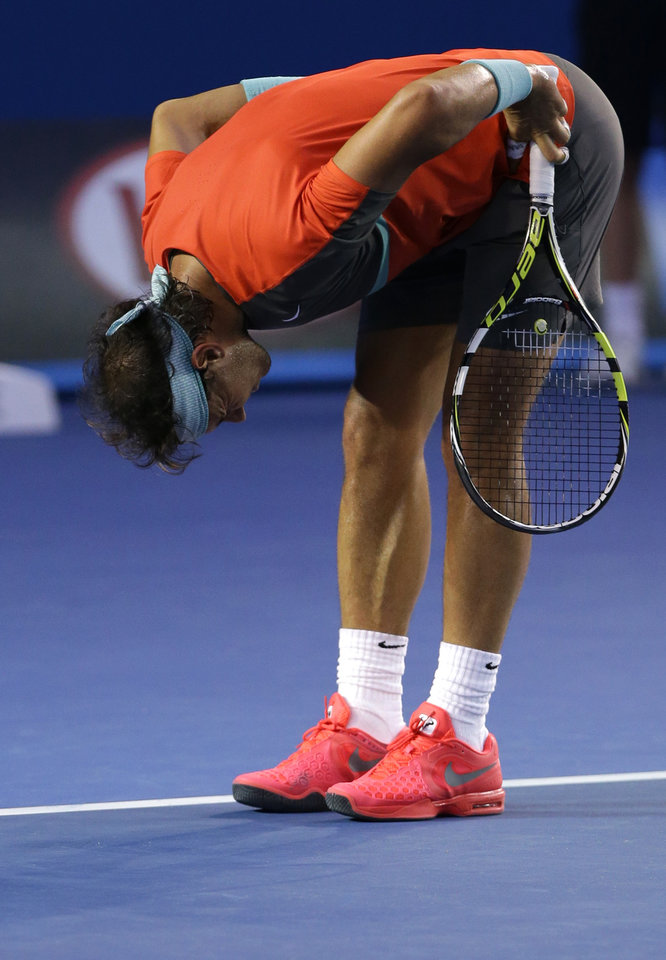 Photo - Rafael Nadal of Spain reacts as he plays Stanislas Wawrinka of Switzerland during the men's singles final at the Australian Open tennis championship in Melbourne, Australia, Sunday, Jan. 26, 2014.(AP Photo/Aaron Favila)