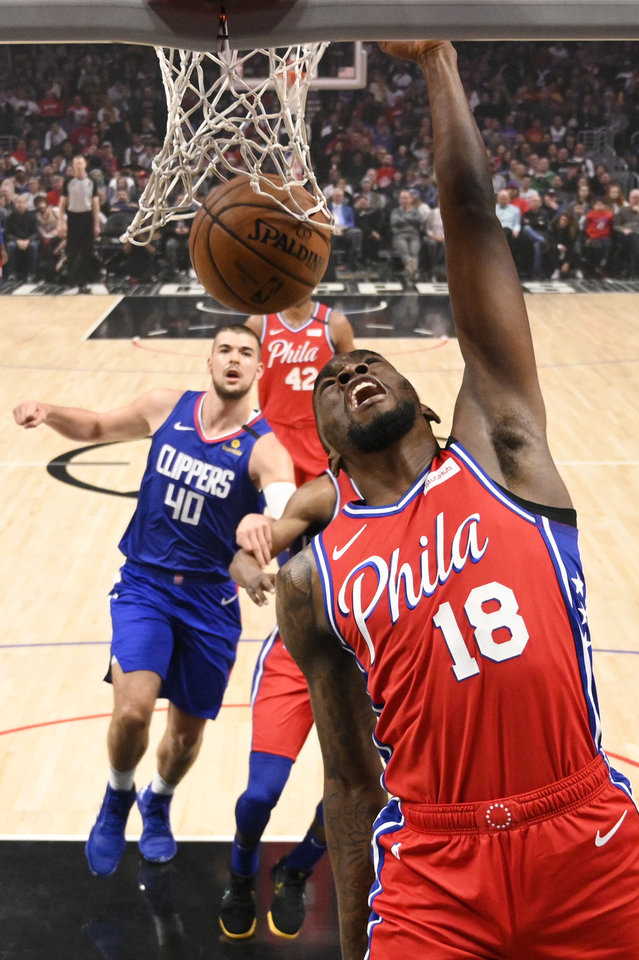 Photo - Philadelphia 76ers guard Shake Milton, right, dunks as Los Angeles Clippers center Ivica Zubac watches during the first half of an NBA basketball game Sunday, March 1, 2020, in Los Angeles. (AP Photo/Mark J. Terrill)