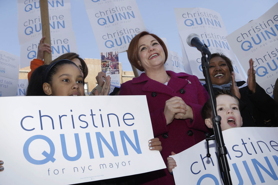 Photo - Surrounded by family and supporters, New York City Council speaker and mayoral hopeful Christine Quinn, center, speaks to the media as she announces her mayoral run in New York, Sunday, March 10, 2013. The New York City Council speaker has formally launched what she hopes will be a history-making mayoral bid this fall. (AP Photo/Seth Wenig)