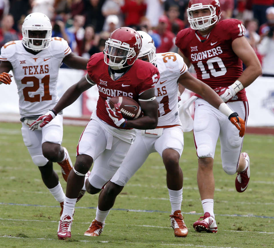 Photo - Oklahoma's Durron Neal (5) runs after a catch during the second half of the Red River Showdown college football game between the University of Oklahoma Sooners (OU) and the University of Texas Longhorns (UT) at the Cotton Bowl in Dallas, Texas on Saturday, Oct. 11, 2014. 