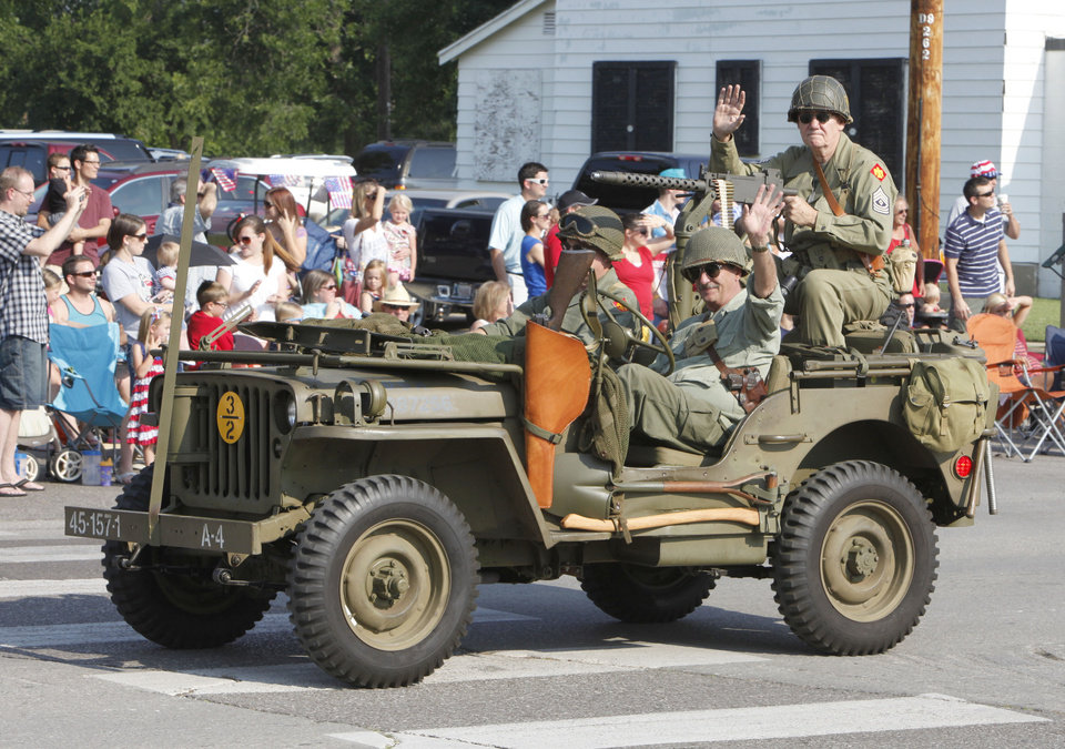 WWII reenactors pass by during the annual LibertyFest Fourth of July Parade in downtown Edmond, OK, Thursday, July 4, 2013,  Photo by Paul Hellstern, The Oklahoman