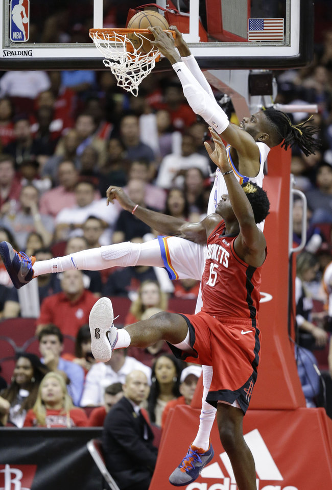 Photo - Oklahoma City Thunder forward Nerlens Noel, top, dunks as Houston Rockets center Clint Capela defends during the second half of an NBA basketball game, Monday, Oct. 28, 2019, in Houston. (AP Photo/Eric Christian Smith)