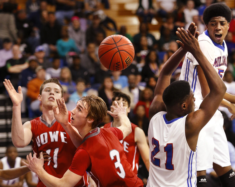 Photo - The ball comes out of Howe player Nick Smallwood's hands while driving into the lane. Smallwood and teammate Brent Hill battle Millwood players Jamal Green-Gaskin, #21, and Ashford Golden, far right, during the Class 2A boys basketball quarterfinal game between Millwood and Howe at Oklahoma City University  on Thursday night, Mar. 13, 2014. Photo by Jim Beckel, The Oklahoman