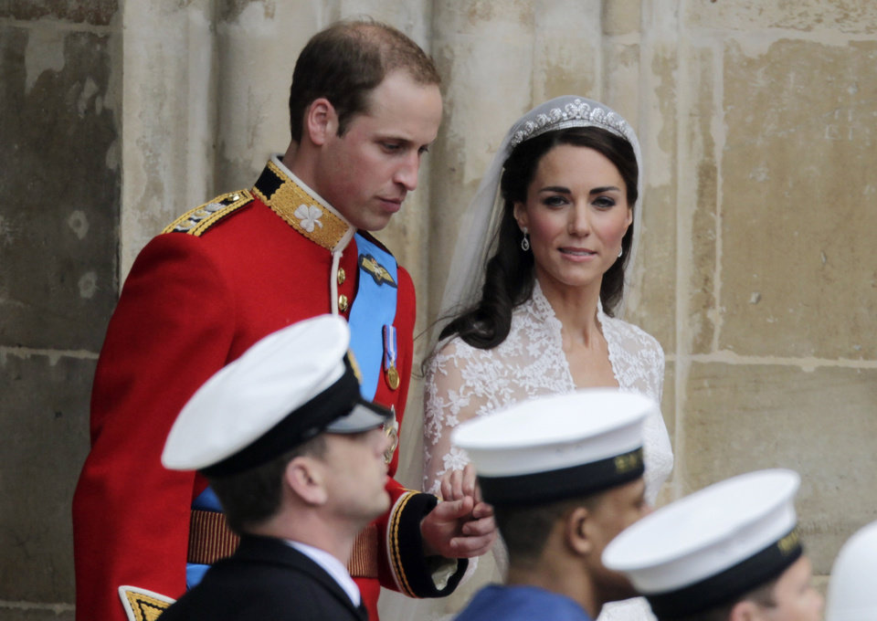 Photo - Britain's Prince William and his wife Kate, Duchess of Cambridge, leave Westminster Abbey at the Royal Wedding in London Friday, April 29, 2011. (AP Photo/Gero Breloer)  ORG XMIT: RWFO140