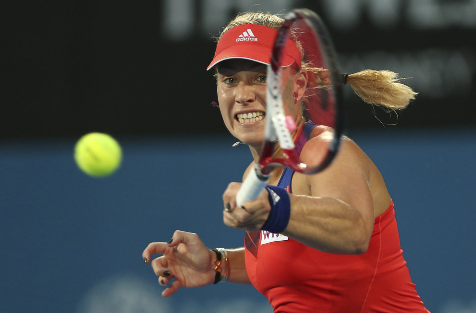 Photo - Angelique Kerber of Germany plays a forehand shot in her finals match against Tsvetana Pironkova of Bulgaria during the Sydney International Tennis Tournament in Sydney, Australia, Friday, Jan. 10, 2014.  Pironkova won the final 6-4, 6-4. (AP Photo/Rob Griffith)