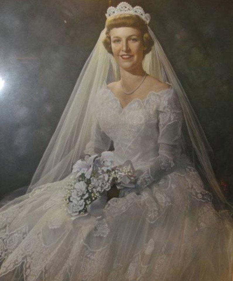 Photo - An affair of the dress. When Jeannine Pridmore Ard chose a dress for her June wedding in 1954, it was decided her sister, Darla Pridmore Coleman, would wear the dress, too, said Traci Alexander, Ard's niece. The dress mirrored the one Jacqueline Kennedy Onassis wore when she married President Kennedy, the only difference was Ard and Coleman's dress had long sleeves. Photo provided by Traci Coleman Alexander.  Provided