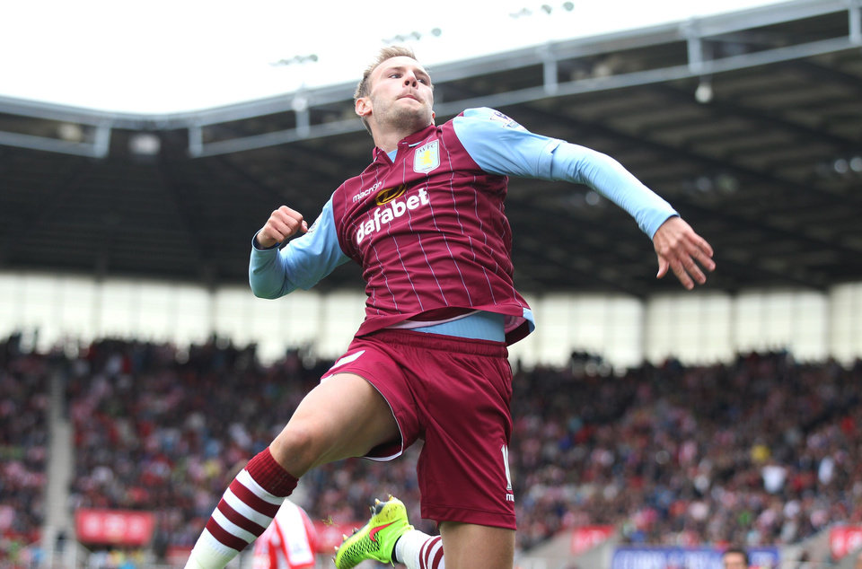 Photo - Aston Villa's Andreas Weimann celebrates scoring his side's first goal of the game during the English Premier League soccer match against Stoke City at The Britannia Stadium, Stoke, England, Saturday, Aug. 16, 2014. (AP Photo/Lynne Cameron, PA Wire)    UNITED KINGDOM OUT    -   NO SALES   -    NO ARCHIVES