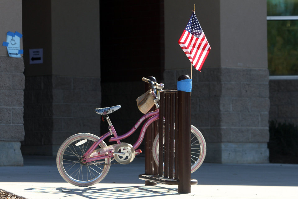 A United States flag taped to a bicycle rack marks a voting precinct at Washington Elementary School in Salt Lake City, Tuesday, Nov. 6, 2012. (AP Photo/The Salt Lake Tribune, Rick Egan) DESERET NEWS OUT; LOCAL TV OUT; MAGS OUT