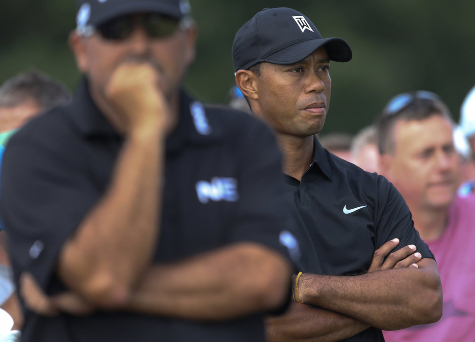 Photo - Tiger Woods of the US, right, and Angel Cabrera of Argentina wait to play on the 10th tee box during the second day of the British Open Golf championship at the Royal Liverpool golf club, Hoylake, England, Friday July 18, 2014. (AP Photo/Peter Morrison)