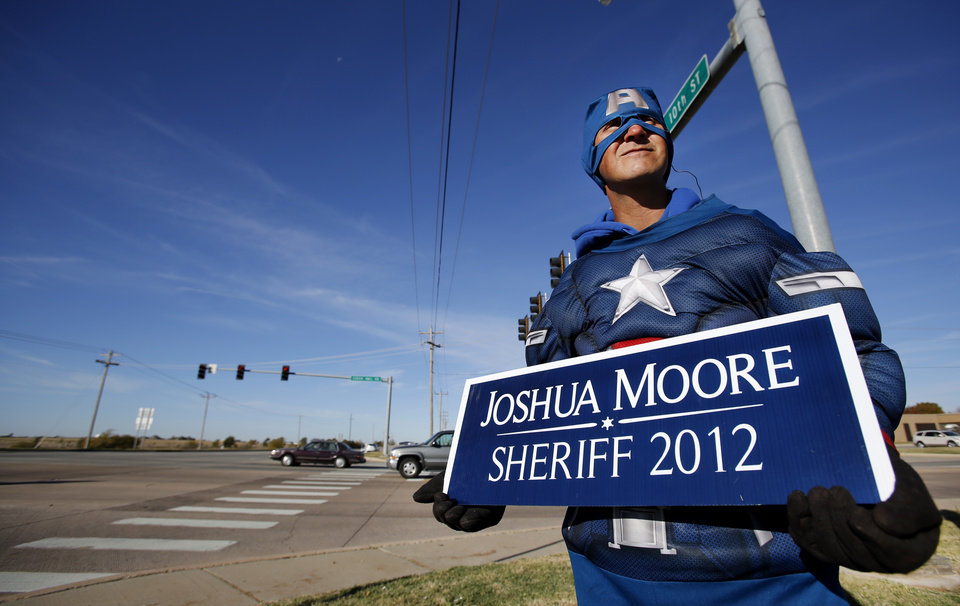 Tommy Reyes holds a campaign sign for Joshua Moore at NW 10th and Czech Hall Road in Yukon, Tuesday November 06, 2012. Moore is running for Sheriff of Canadian County. Photo By Steve Gooch, The Oklahoman