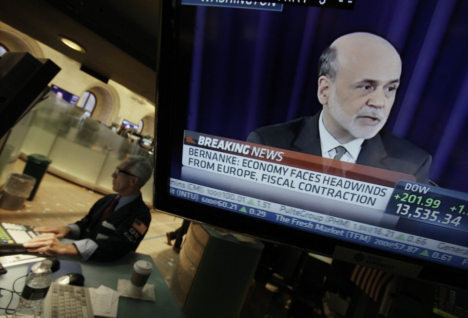 Photo -   FILE - In this Thursday, Sept. 13, 2012 file photo, Specialist David Pologruto works at his post on the floor of the New York Stock Exchange, as Federal Reserve Chairman Ben Bernanke holds a news conference in Washington, Thursday, Sept. 13, 2012. No sooner did the Federal Reserve unveil a bold plan to juice the U.S. economy than it dangled the prospect of doing even more. Investors celebrated by sending stock prices jumping. Economists were less impressed. Many wonder how much the Fed's action would help. (AP Photo/Richard Drew, File)