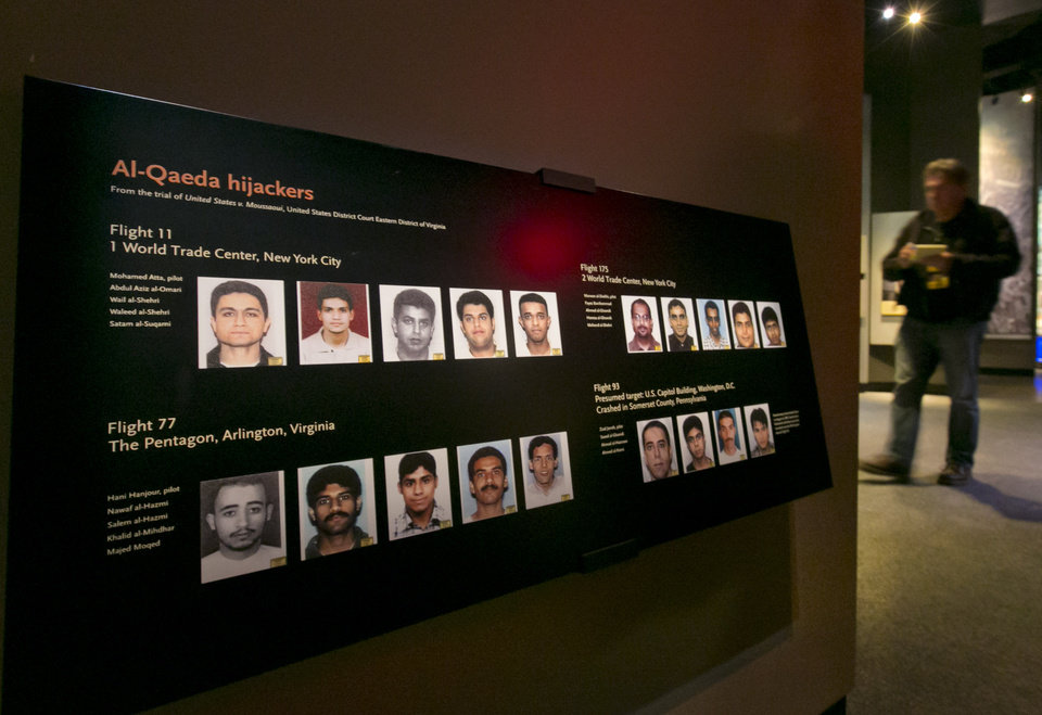 Photo - Portraits of the Al-Qaeda hijackers are displayed at the National Sept. 11 Memorial Museum, Wednesday, May 14, 2014, in New York. The museum is a monument to how the Sept. 11 terror attacks shaped history, from its heart-wrenching artifacts to the underground space that houses them amid the remnants of the fallen twin towers' foundations. It also reflects the complexity of crafting a public understanding of the terrorist attacks and reconceiving ground zero.  (AP Photo)