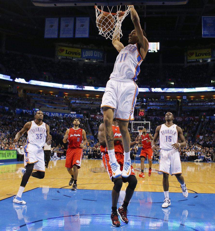 Oklahoma City's Jeremy Lamb (11) dunks the ball during an NBA basketball game between the Oklahoma City Thunder and the Los Angeles Clippers at Chesapeake Energy Arena in Oklahoma City, Thursday, Nov. 21, 2013. Oklahoma City won 105-91. Photo by Bryan Terry, The Oklahoman