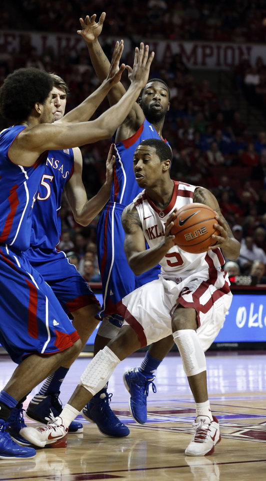 Oklahoma's Je'lon Hornbeak (5) finds Kansas defenders as the University of Oklahoma Sooners (OU) play the Kansas Jayhawks (KU) in NCAA, men's college basketball at The Lloyd Noble Center on Saturday, Feb. 9, 2013 in Norman, Okla. Photo by Steve Sisney, The Oklahoman