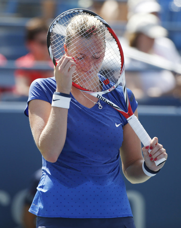 Photo - Petra Kvitova, of the Czech Republic, reacts after a shot against Aleksandra Krunic, of Serbia, during the third round of the 2014 U.S. Open tennis tournament, Saturday, Aug. 30, 2014, in New York. (AP Photo/Kathy Willens)