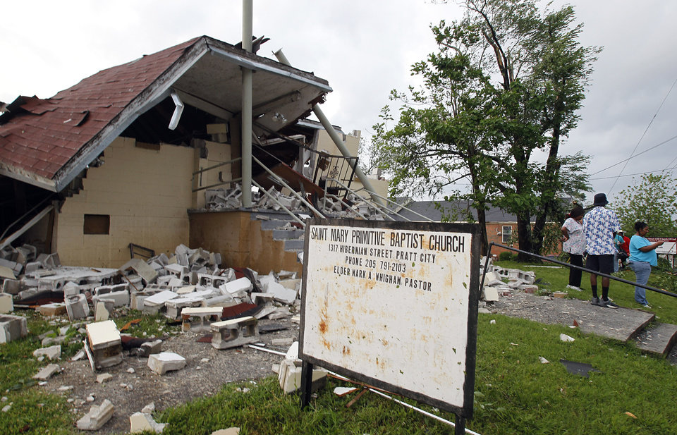 Photo - People stand outside the Saint Mary Primitive Baptist Church that was totally destroyed when a tornado hits Pratt City just north of downtown Birmingham on Wednesday, April 27, 2011, in Birmingham, Ala. (AP Photo/Butch Dill)