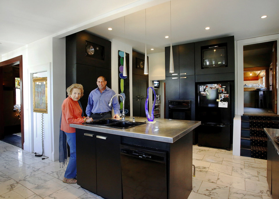 Mary Khoury and her son, Michael, stand in the remodeled and modern kitchen of his 102-year-old home home at 1005 NW 18. <strong>Jim Beckel - THE OKLAHOMAN</strong>