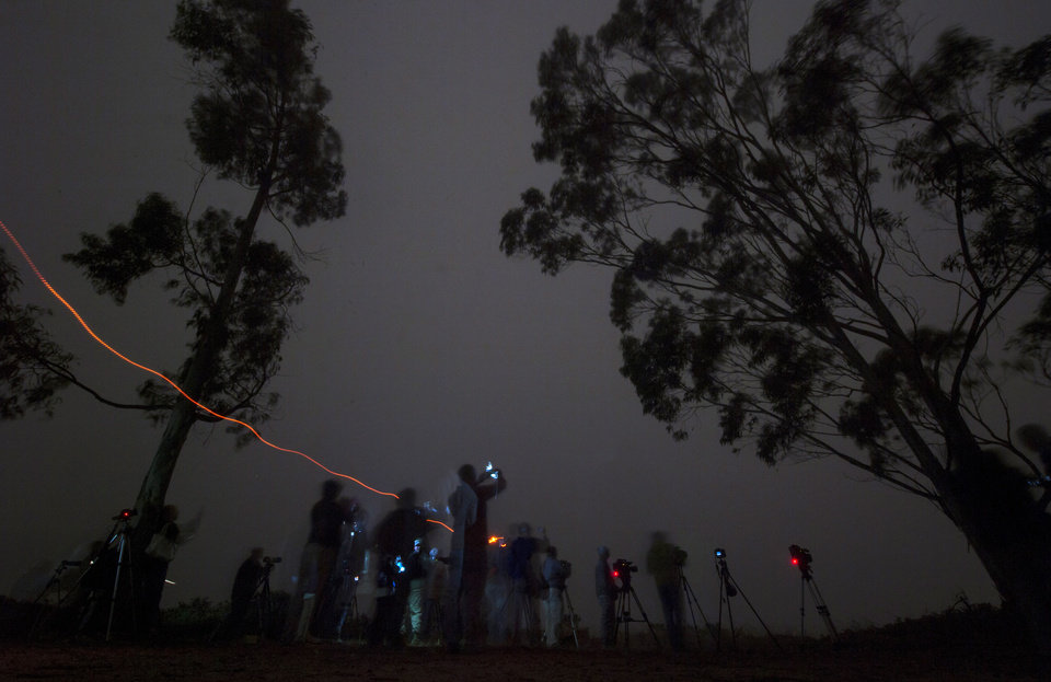 In this image released by NASA, members of the media are unable to capture the launch of the Delta 2 rocket with the Orbiting Carbon Observatory-2 satellite onboard due to heavy fog at Vandenberg Air Force Base, Calif., Wednesday morning, July 2, 2014.  The goal of the $468 million mission, designed to last at least two years, is to study the processes behind how the environment absorbs carbon dioxide.  (AP Photo/NASA, Bill Ingalls) MANDATORY CREDIT