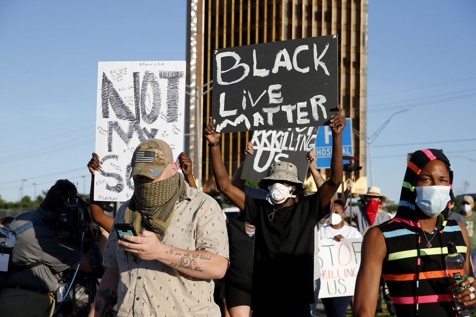 Photo - Protestor march during a protest near the intersection of 23rd and Classen in Oklahoma City, Saturday, May 30, 2020. The protest was in response to the death of George Floyd. [Sarah Phipps/The Oklahoman]