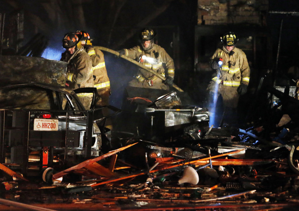 Firemen walk through the remains of a house destroyed by a natural gas explosion near SW 92nd and Fairview on Thursday, Jan. 3, 2013  in Oklahoma City, Okla. Photo by Steve Sisney, The Oklahoman