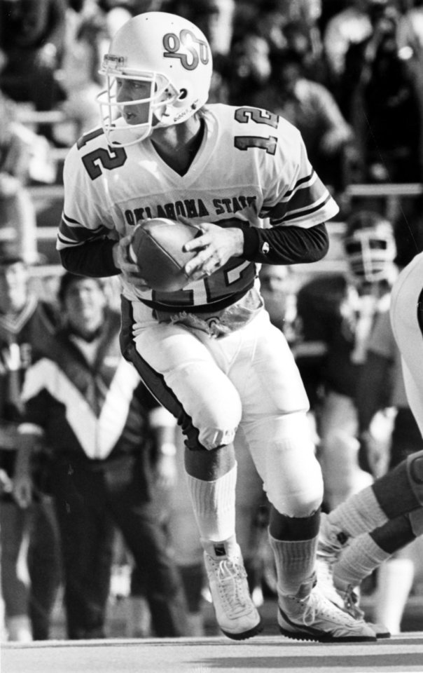 Photo - OSU COLLEGE FOOTBALL: Oklahoma State University quarterback Mike Gundy on the move in Lawrence, KS, during the Cowboys' 49-17 win over the Kansas Jayhawks on November 14, 1987. Staff photo by Jim Argo taken 11/14/87; similar photo appeared in the 11/16/87 Daily Oklahoman.