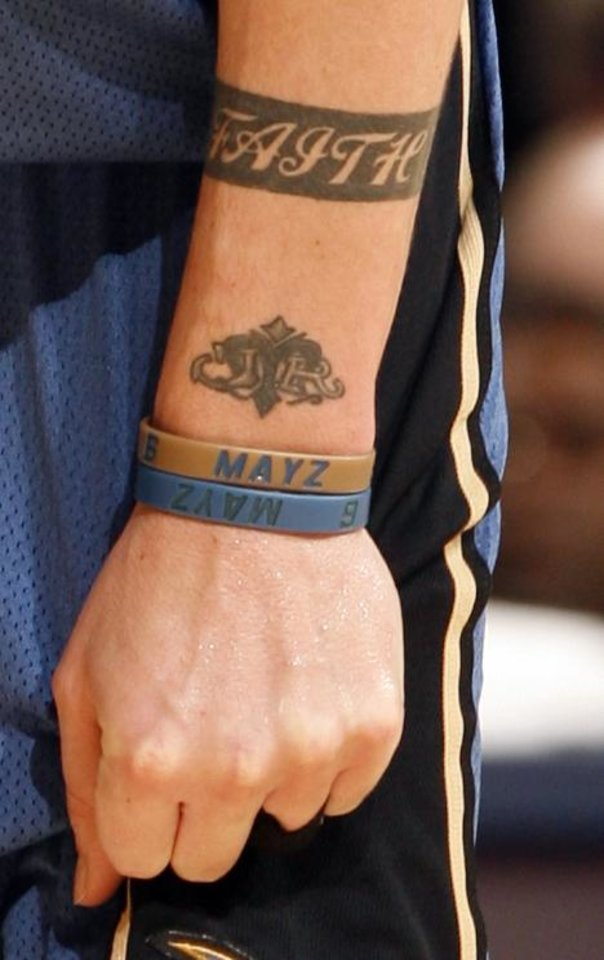 Photo - Wizard's Mike Miller (6) has a faith tatoo on his arm.  He is photographed as the Oklahoma City Thunder NBA basketball team defeats the Washington Wizards 127-108 at the Ford Center on Friday, Nov. 20, 2009, in Oklahoma City, Okla.  Photo by Steve Sisney, The Oklahoman ORG XMIT: KOD