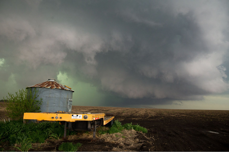 Photo - CORRECTS CREDIT TO CHRIS MACHIAN - In this Sunday May 11, 2014 photo, a wall cloud that spawned a tornado warning forms northwest of Dorchester Neb. Sunday's storms caused damage across much of eastern Nebraska roughly on a line from the Kansas border up through Hastings and Omaha. No serious injuries were reported. (AP Photo/The World-Herald, Chris Machian)  MAGS OUT TV OUT