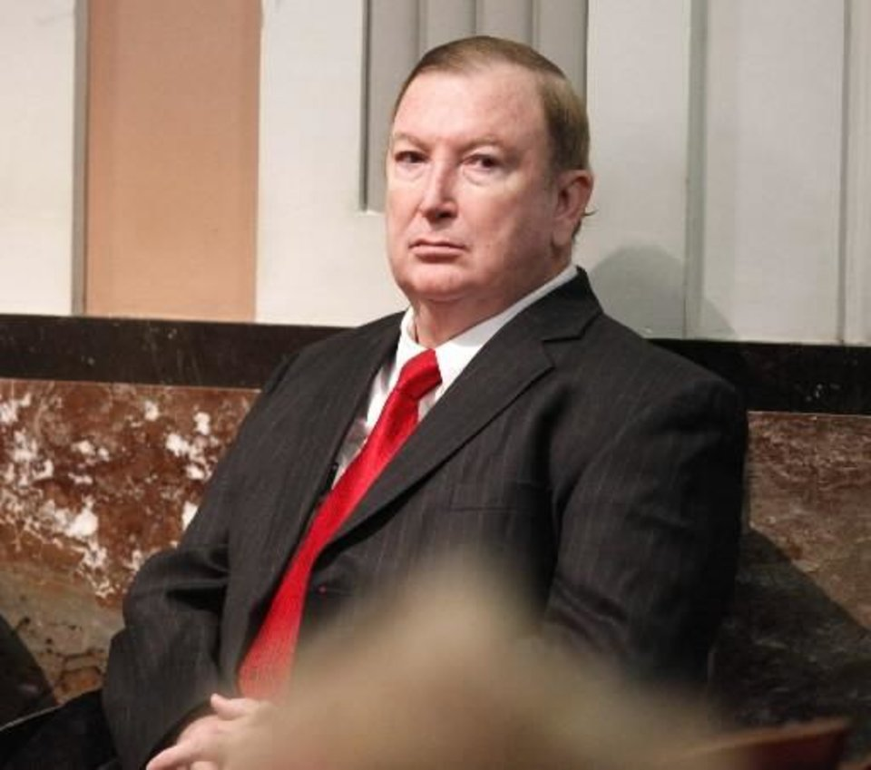 Pharmacist Jerome Ersland sits in the courtroom of Judge Ray Elliott at the Oklahoma County Courthouse in Oklahoma City, OK, as the judge conducts a hearing on a request for him to step down from his trial, Monday, Dec. 6, 2010. By Paul Hellstern, The Oklahoman