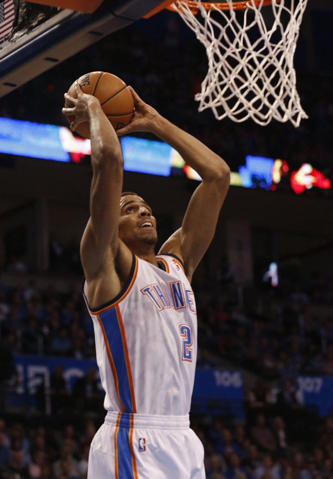 Oklahoma City Thunder\'s Thabo Sefolosha (2) dunks the ball as the Oklahoma City Thunder play the Atlanta Hawks in NBA basketball at the Chesapeake Energy Arena in Oklahoma City, on Sunday, Nov. 4, 2012. Photo by Steve Sisney, The Oklahoman