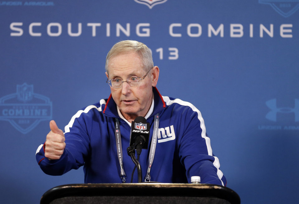 Photo - New York Giants head coach Tom Coughlin answers a question during a news conference at the NFL football scouting combine in Indianapolis, Friday, Feb. 22, 2013. (AP Photo/Michael Conroy)