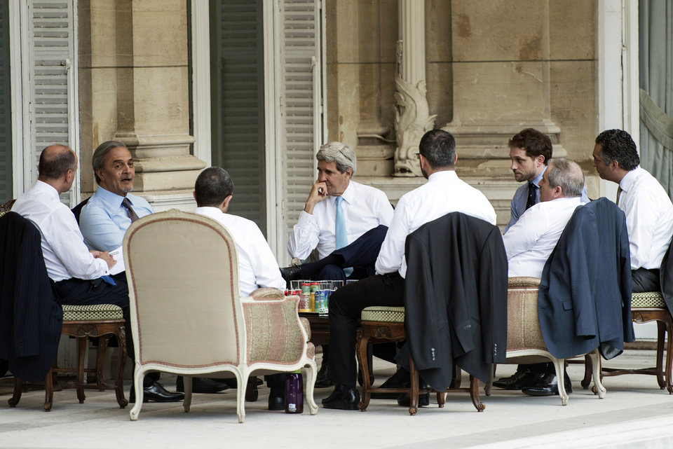 Photo - Saudi Foreign Minister Prince Saud al-Faisal, 2nd left, United Arab Emirates Foreign Minister Abdullah Bin Zayed, 3rd left, and US Secretary of State John Kerry, 4th left, meet with staff members on the terrace of the US Chief of Mission Residence in Paris, France. US Secretary of State John Kerry arrived in Paris on June 26, 2014 after stops in Baghdad, Arbil and Brussels to brief his Saudi, French and Israeli counterparts on his talks in Iraq and discuss the bloody three-year war in Syria. (AP Photo/Brendan Smialowski, pool)