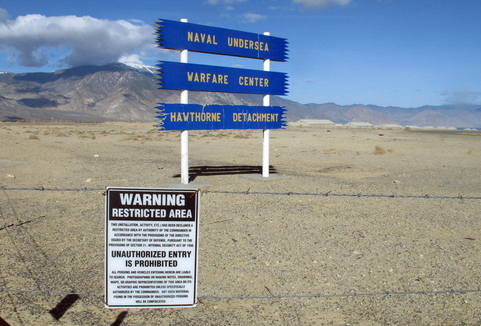 Photo - Signs are seen at the Hawthorne Army Depot on Tuesday, March 19, 2013, where seven Marines were killed and several others seriously injured in a training accident Monday night, about 150 miles southeast of Reno in Nevada's high desert. (AP Photo/Scott Sonner)