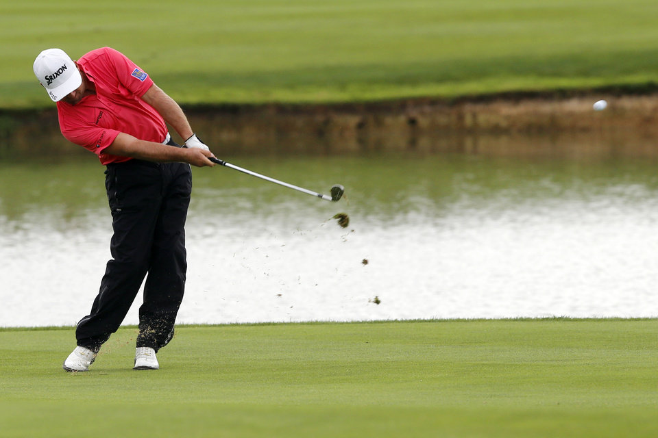 Photo - Graeme McDowell of Northern Ireland plays a shot, during the last day of the French Open Golf tournament at Paris National course in Guyancourt, west of Paris, France, Sunday, July 6, 2014. (AP Photo/Francois Mori)