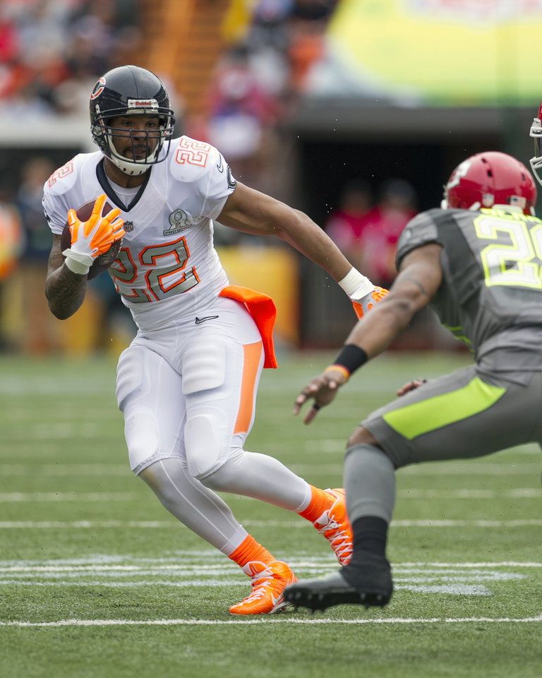 Photo - Kansas City Chiefs wide receiver Dexter McCluster (22). of Team Rice. tries to get past Kansas City Chiefs safety Eric Berry (29). of Team Sanders. during the first quarter at the NFL Pro Bowl football game at Aloha Stadium, Sunday. Jan. 26, 2014, in Honolulu. (AP Photo/Marco Garcia)