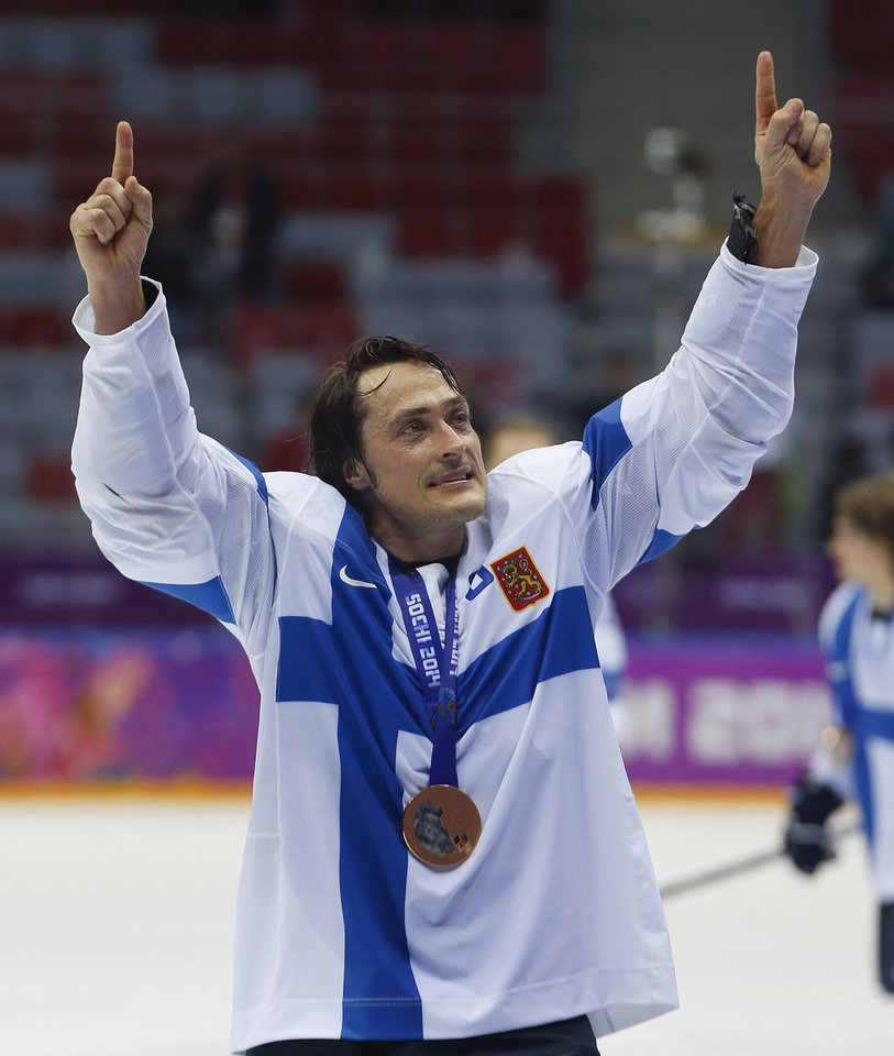 Photo - Finland forward Teemu Selanne points to fans after Finland beat the USA 5-0 in the men's bronze medal ice hockey game at the 2014 Winter Olympics, Saturday, Feb. 22, 2014, in Sochi, Russia. (AP Photo/Petr David Josek)