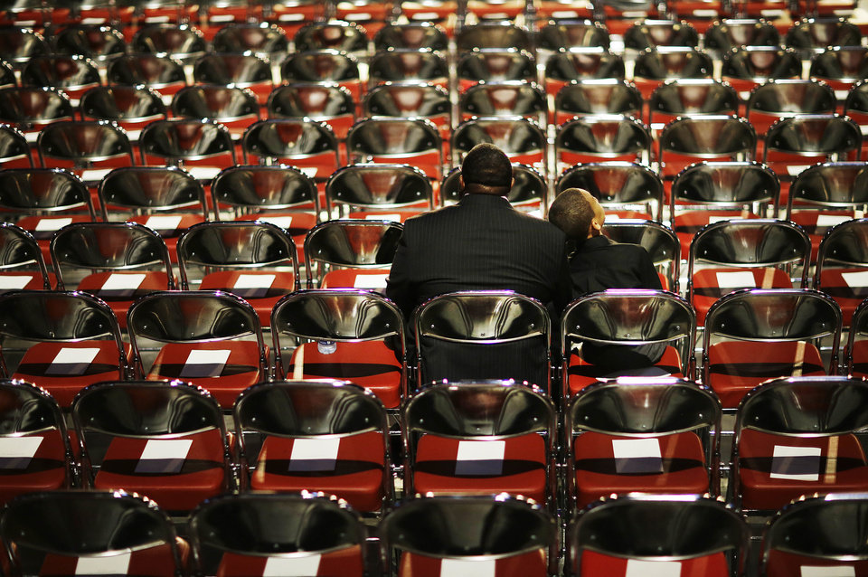Photo - Stephfon Moran, left, sits with his grandson Kevin Slaughter, 9, as they wait for Muhammad Ali's memorial service to begin Friday, June 10, 2016, in Louisville, Ky. (AP Photo/David Goldman)