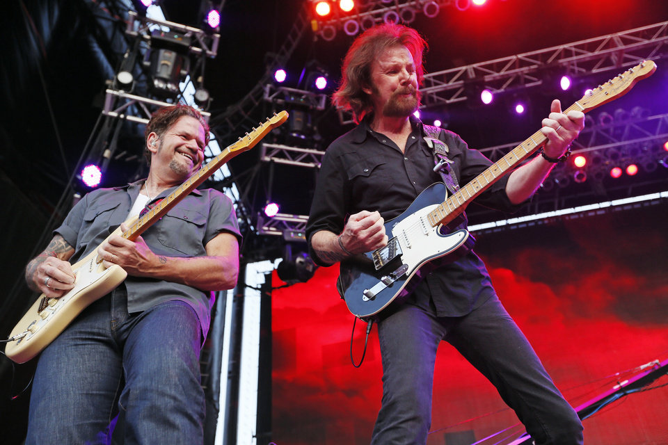 Photo - Ronnie Dunn, right, performs during the Oklahoma Twister Relief Concert, benefiting victims of the May tornadoes, at Gaylord Family - Oklahoma Memorial Stadium on the campus of the University of Oklahoma in Norman, Okla., Saturday, July 6, 2013. Photo by Nate Billings, The Oklahoman
